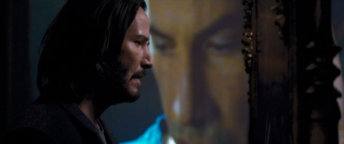 Neo walks in front of a version of Neo from The Matrix in The Matrix Resurrections